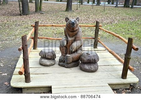 Wooden bear sitiing and waiting