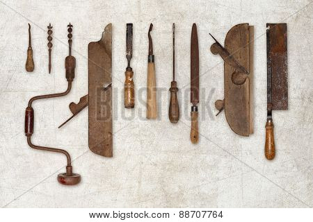 composition of old tools for wood isolated on wall