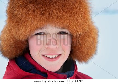 Portrait Of Teenager Wearing Fur Hat