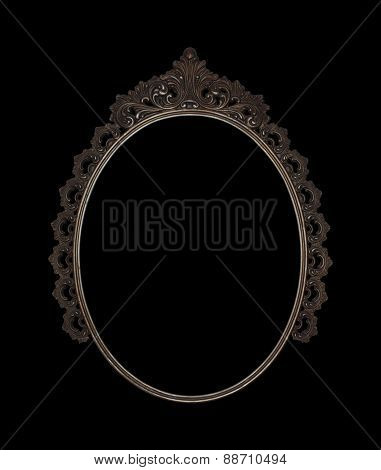 old oval picture frame metal worked on black background