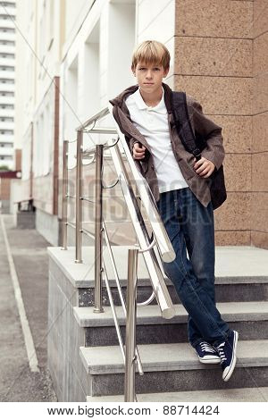 Serious Boy Standing On Stairs