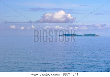 Cloudy sky and island in the Mediterranean Sea
