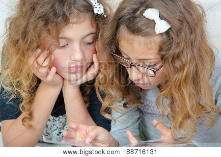 Two girls looking at book