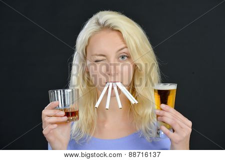 Blond woman both  smoking and drinking