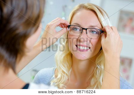 Fitting glasses onto a lady