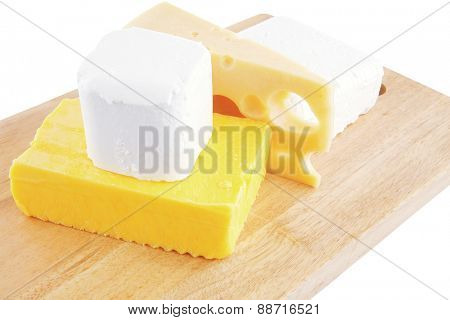 white soft cheeses and yellow danish on wood