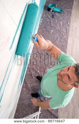 man painting white old wall