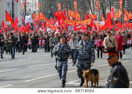 MOSCOW, RUSSIA - MAY 1, 2010: During the celebration of May Day in the centre of Moscow. Communist party supporters take part in a rally.