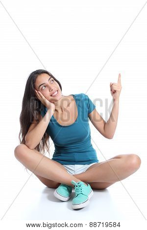 Teenager Girl Sitting And Pointing At Side