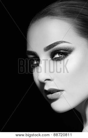 Black and white portrait of young beautiful woman with smoky eyes, copy space