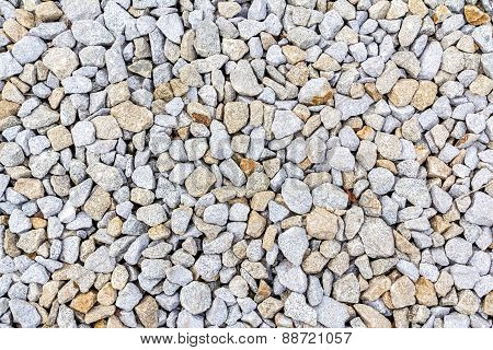 Crushed rock, gravel granite stones close-up.