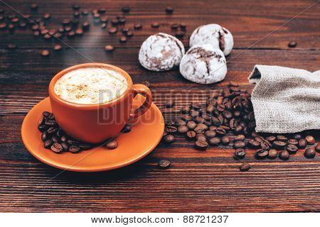 Coffee with cookies and coffee beans