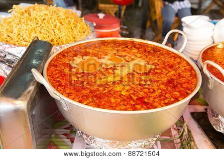 cooking, asian kitchen, sale and food concept - pot of spicy soup at street market