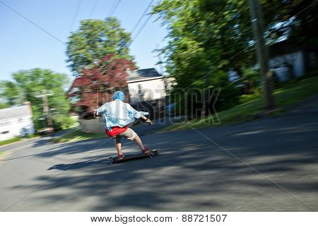 Longboarder Speeding Downhill