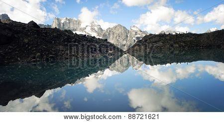View Of Distant Peaks. Calm Alpine Lake. Caucasus Mountains, Russia.