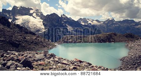 View Of Distant Peaks. Bright Blue Water In The Alpine Lake.