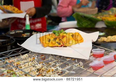 cooking, asian kitchen, sale and food concept - close up of snack at street market