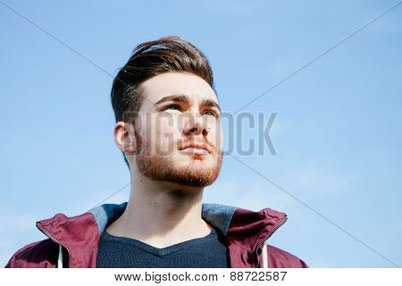 Portrait of casual cool young man with beard