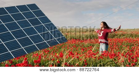Solar Energy Panel And Teenage Girl On A Field With Red Poppies.