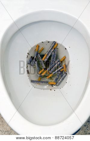 Toilet Full Of Cigarettes Stop Smoking Concept