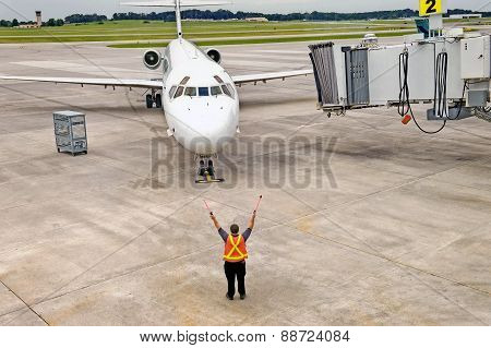 Airplane Arriving At Gate