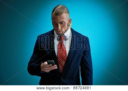 Portrait of an attractive young businessman wearing black suit