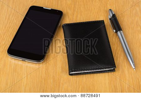 Modern Mobile Phone With Touchscreen, Notepad And Pen