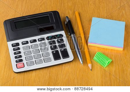 Electronic Calculator, Paper, Pen, Sharpener  And Pencil