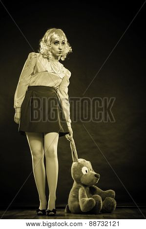 Childlike Woman With Dog Toy On Black