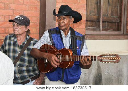 Group Of Men Playing Guitar