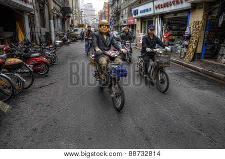 Two-wheeled Motorized Vehicles On A Street In Shanghai, China.