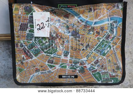 VIENNA, AUSTRIA - FEBRUARY 12, 2012: Map of Vienna depicted on the map bag seen in a shop window in Vienna, Austria.