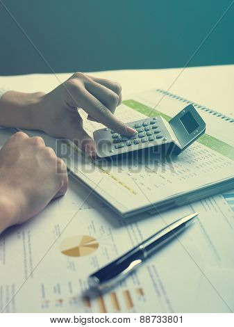 Analyzing Business Data - pen and numbers on paper