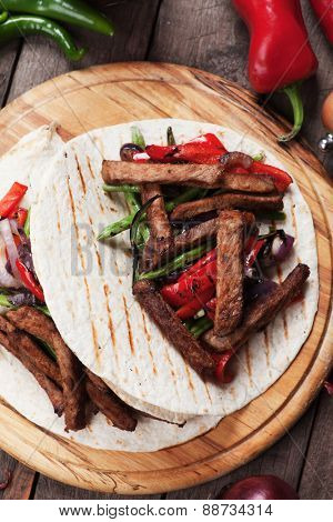 Fajitas, mexican beef with grilled vegetable and tortillas