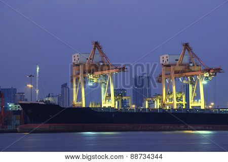 Beautiful Of Container Ship In Port With Lighting And Dusky Sky Background