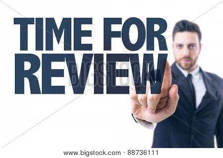 Business man pointing the text: Time For Review