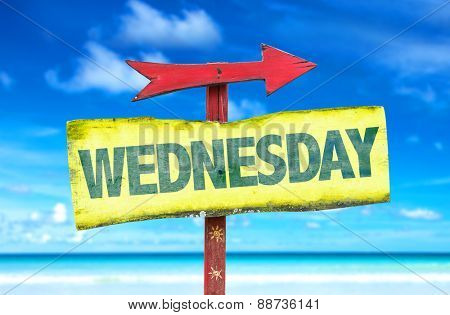 Wednesday sign with beach background