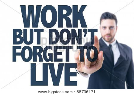 Business man pointing the text: Work But Don't Forget to Live