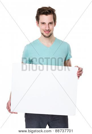Caucasian man shows with white board