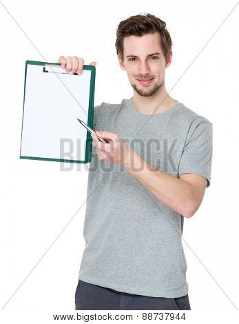 Student pen point to clipboard