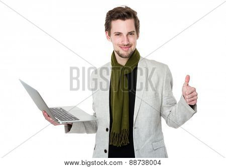Man uses laptop and thumb up
