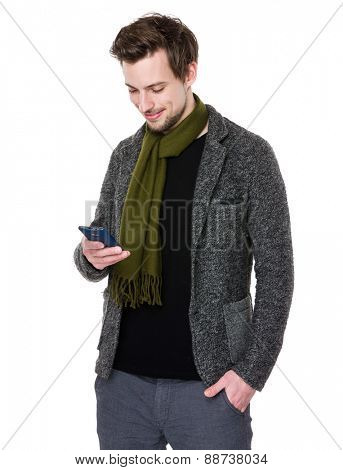 Caucasian man looks at cellphone