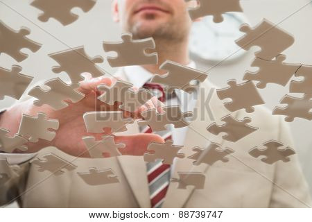 Businessman Separating Puzzle