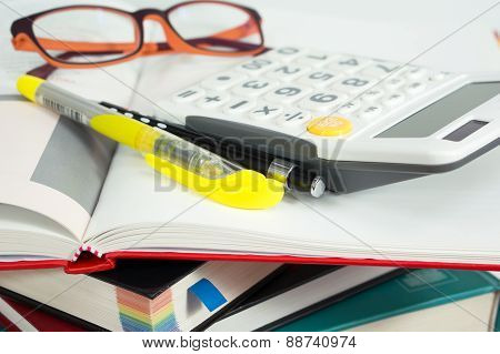 Books With Marker Pen And Calculator