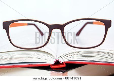 Eyeglasses Closeup With Book