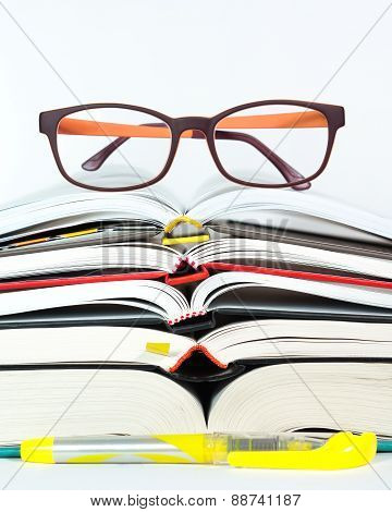 Open Book Stack With Reading Glasses