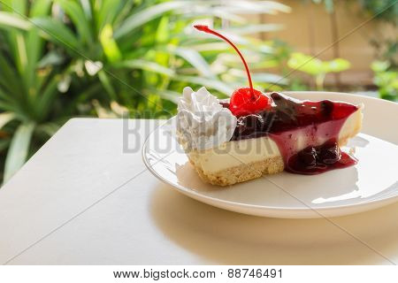 Blueberry Cheese Cake With Cherry On Top