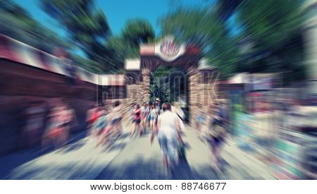 Abstract Background. Pedestrians Walking - Rush Hour In Barcelona, Park Guell, Spain.  Radial Zoom B
