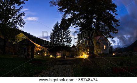 Studenica monastery yard during evening prayer