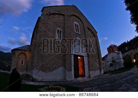 Church inside Studenica monastery during evening prayer